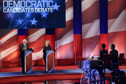 Debate moderators Rachel Maddow and Chuck Todd listen as Democratic presidential candidates, Sen. Bernie Sanders, I-Vt,  and former Secretary of State, Hillary Clinton answer questions during a Democratic presidential primary debate hosted by MSNBC at the University of New Hampshire Thursday, Feb. 4, 2016, in Durham, N.H. (AP Photo/David Goldman)