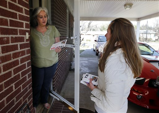Volunteer Beth Avery, right, of Gambrills, Md., speaks with Denise Mahon, while campaigning for Republican presidential candidate Sen. Ted Cruz, R-Texas, Tuesday, Feb. 16, 2016, in Greenville, S.C. For months, Cruz's campaign has touted an expensive and sophisticated get-out-the-vote operation as its antidote to Donald Trump's broad populist appeal. It worked in Iowa. But Saturday's South Carolina primary will be a tougher test for him. And it could shape the race between the anti-establishment rivals as the GOP contest heads toward delegate-rich March voting states. (AP Photo/Paul Sancya)