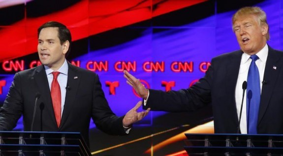 Republican U.S. presidential candidates Marco Rubio (L) and Donald Trump speak simultaneously at the debate sponsored by CNN for the 2016 Republican U.S. presidential candidates in Houston, Texas, February 25, 2016. REUTERS/Mike Stone
