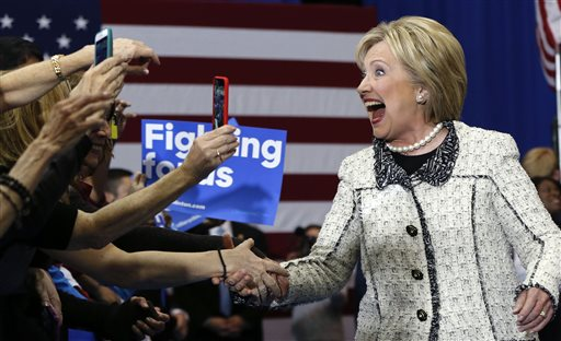 Democratic presidential candidate Hillary Clinton greets supporters at her election night watch party after winning the South Carolina Democratic primary in Columbia, S.C., Saturday, Feb. 27, 2016. (AP Photo/Gerald Herbert)