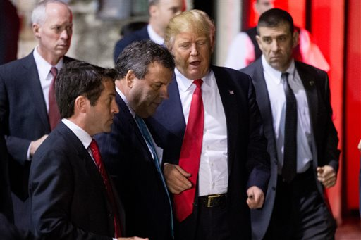 Republican presidential candidate Donald Trump, center right, speaks with New Jersey Gov. Chris Christie, center left, following a rally at Millington Regional Airport in Millington, Tenn., Saturday, Feb. 27, 2016. (AP Photo/Andrew Harnik)