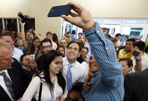 Republican presidential candidate, Sen. Marco Rubio, R-Fla., poses for photographs at a rally in Toa Baja, Puerto Rico, Saturday, March 5, 2016. (AP Photo/Paul Sancya)