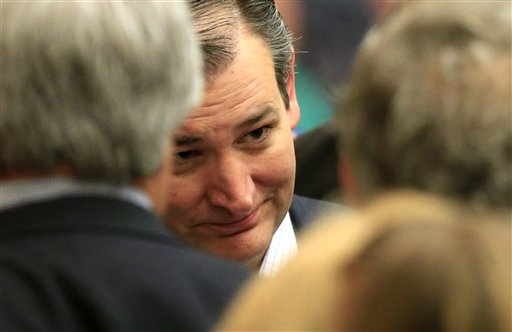 Republican presidential candidate, Sen. Ted Cruz, R-Texas, listens to a supporters at a caucus site, Saturday, March 5, 2016, in Wichita, Kan., (AP Photo/Orlin Wagner)