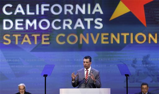 """In this Saturday, Feb. 27, 2016, photo California Secretary of State Alex Padilla gestures while speaking before the California Democrats State Convention in San Jose, Calif. """"There's no other fundamental right we have as citizens that requires you to register or fill out a form,"""" said Padilla, who advocated for a California legislation for automatic registration bills. (AP Photo/Ben Margot)"""