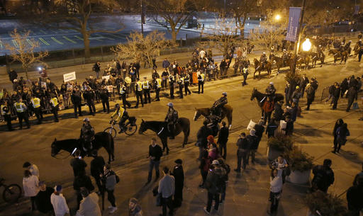 Chicago police officers on foot and mounted, watch over protesters after a rally for Republican presidential candidate Donald Trump was cancelled due to security concerns, on the campus of the University of Illinois-Chicago, Friday, March 11, 2016, in Chicago. (AP Photo/Charles Rex Arbogast)
