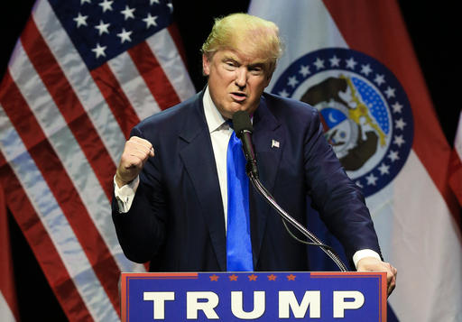 Republican presidential candidate Donald Trump describes how he was ready to punch a person who rushed the stage during an election rally earlier in the day, as he speaks to a crowd in Kansas City, Mo., Saturday, March 12, 2016. (AP Photo/Nati Harnik)