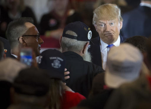 "Republican presidential candidate Donald Trump reacts as veteran Keith Moppin asks the candidate to clarify comments he made about Arizona Sen. John McCain during a campaign stop at the Savannah Center, Sunday, March 13, 2016, in West Chester, Ohio. Trump said in July while campaigning in Iowa that he dismissed the notion that McCain, the 2008 Republican nominee for president, was a hero ""Because he was captured."" Trump said, ""I like people who weren't captured."" (AP Photo/John Minchillo)"