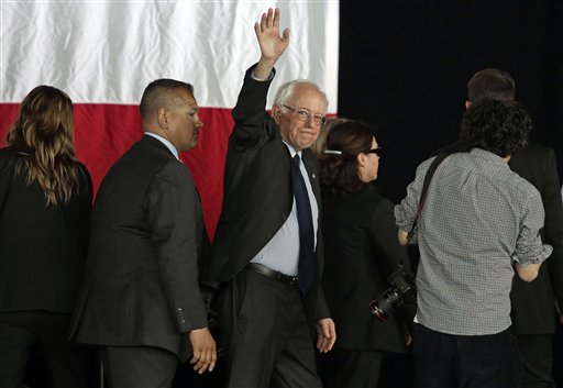 Democratic presidential candidate, Sen. Bernie Sanders, I-Vt., waves to supporters as he leaves the stage after a rally in Charlotte, N.C., Monday, March 14, 2016. (AP Photo/Chuck Burton)