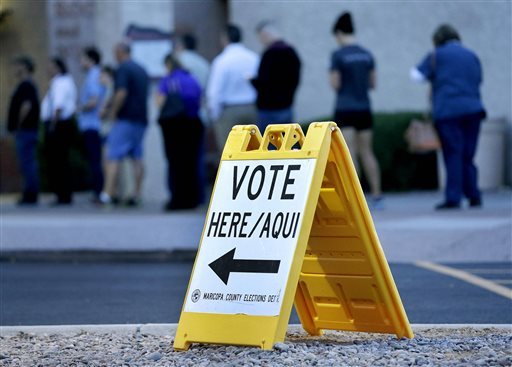 Voters wait in line at dawn to cast their ballot in Arizona's presidential primary election, Tuesday, March 22, 2016, in Phoenix. (AP Photo/Matt York)