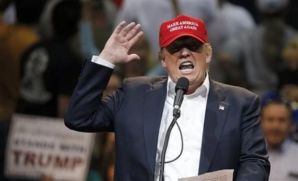 File-In this March 19, 2016, file photo, Republican presidential candidate Donald Trump speaks during a campaign rally in Tucson, Ariz.  Trump is planning Tuesday to make his first campaign visit to Wisconsin, where the upcoming Republican presidential primary could mark a turning point in the unpredictable GOP race. But rival Ted Cruz has gotten a jumpstart on the contest, racking up influential endorsements, campaigning in key regions and supported by bullish advertising campaign.  (AP Photo/Ross D. Franklin)