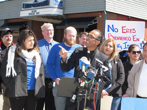 The Rev. Alan Ramirez, an adviser to the family of Marcelo Lucero, speaks at a press conference in Patchogue, N.Y., on Wednesday, April, 13, 2016. Ramirez is calling for Donald Trump to cancel a planned appearance at a Suffolk County Republican Committee fundraiser on Thursday, April 14, in Patchogue, because it is being held at a nightclub just blocks from where a gang of teenagers killed Lucero in November 2008. (AP Photo/Frank Eltman)