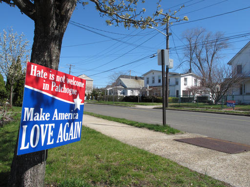 A sign sits near the site where Marcelo Lucero was killed in Patchogue, N.Y., on Wednesday, April, 13, 2016. The Rev. Alan Ramirez, an adviser to the family of Lucero, has called for Donald Trump to cancel a planned appearance at a Suffolk County Republican Committee fundraiser on Thursday, April 14, in Patchogue, because it is being held at a nightclub just blocks from where a gang of teenagers killed Lucero in November 2008. (AP Photo/Frank Eltman)