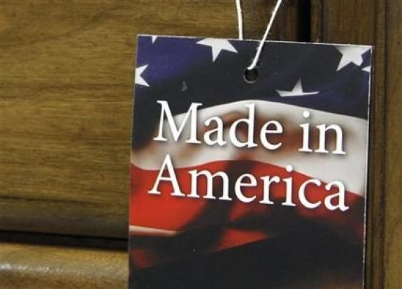 """In this March 16, 2012 file photo, a """"Made in America"""" tag hangs on a chest of drawers at a furniture factory in Lincolnton, N.C. The vast majority of Americans say they prefer lower prices instead of paying a premium for items labeled """"Made in the U.S.A.,"""" even if it means those cheaper items are made abroad, according to an Associated Press-GfK poll. (AP Photo/Bob Leverone, File)"""