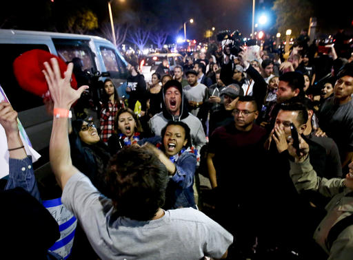 A Trump supporter clashes with protesters outside a rally for Republican presidential candidate Donald Trump, Thursday, April 28, 2016 in Costa Mesa, Calif. (AP Photo/Chris Carlson)