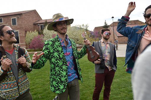 Drew Wyman talks with friends while they visited Farrand Field to see what was going on for 4/20 on the University of Colorado Boulder campus Wednesday, April 20, 2016, in Boulder, Colo. Public consumption remains illegal under the state's recreational pot law, which was passed in 2012. Fans of the drug have long marked April 20 as a day to enjoy pot — especially at 4:20 p.m. — and to call for increased legal access to it. (Autumn Parry/Daily Camera via AP) NO SALES; MANDATORY CREDIT