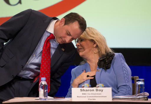 Republican National Committee (RNC) Chairman Reince Priebus, left, speaks with Sharon Day, RNC co-chairman and National Committeewoman for Florida, during the general session of the Republican National Committee Spring Meeting, Friday, April 22, 2016, in Hollywood, Fla. (AP Photo/Wilfredo Lee)