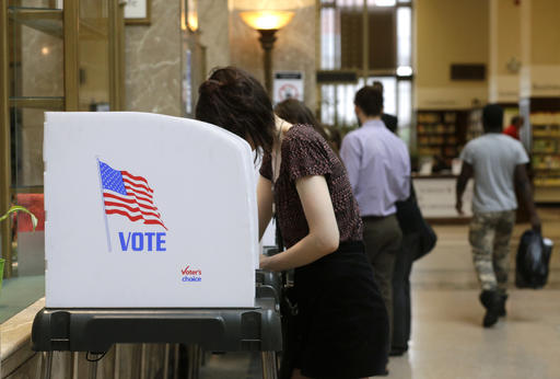 People cast their votes at a polling station inside the Enoch Pratt Free Library's central library branch in Baltimore, Tuesday, April 26, 2016. Maryland voters have many choices and deeper impact than in recent elections as they make their choices about who should run for president and pick candidates for an open U.S. Senate seat. (AP Photo/Patrick Semansky)