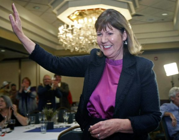 """FILE - In this Nov. 6, 2012 file photo, Ann Kirkpatrick, waves as she enters a room full of supporters during an election night in Flagstaff, Ariz. If 2016 has been the Year of Trump in politics, it may also end up being a new Year of the Woman, if Democrats get their way. And that won't be a coincidence. """"I'll tell you as a professional woman, too many women have had to fight Donald Trump's type of sexism and offensive rhetoric their entire lives,"""" said Rep. Ann Kirkpatrick, who is challenging Republican Sen. John McCain and released an early ad in February tying the incumbent to Trump. (AP Photo/Ralph Freso, File)"""