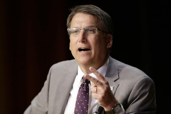 FILE- In this May 4, 2016, file photo, North Carolina Gov. Pat McCrory makes remarks concerning House Bill 2, which limits protections to lesbian, gay, bisexual and transgender people, while speaking during a government affairs conference in Raleigh, N.C. McCrory shows no signs of backing down in the face of the federal government's Monday, May 9, deadline to declare he won't enforce the new state law. (AP Photo/Gerry Broome, File)