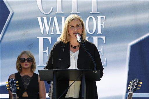 FILE - In this Oct. 6, 2015 file photo, Nashville Mayor Megan Barry addresses the crowd at Music City Walk of Fame Induction Ceremony at Walk of Fame Park in Nashville, Tenn. The American Counseling Association's leader says the group hopes to send a message by canceling its conference in Nashville in 2017. The cancellation comes after the Tennessee General Assembly passed a new law allowing therapists to decline to see patients based on religious values and personal principles. Mayor Barry and tourist officials in the Music City have vocally opposed the legislation and warned of a possible backlash. (Photo by Al Wagner/Invision/AP, File)