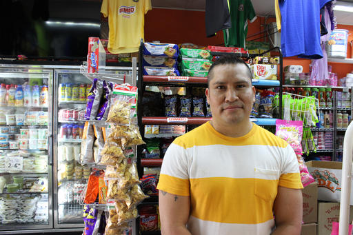In this photo taken May 9, 2016, Miguel Maravillo is seen at the Tienda y Taqueria La Fiesta Mexicana in Janesville, Wis. Maravillo, 40, has criticized Donald Trump's generalizations about immigrants, saying it was brave of House Speaker Paul Ryan to voice his hesitation.  (AP Photo/Bryna Godar)