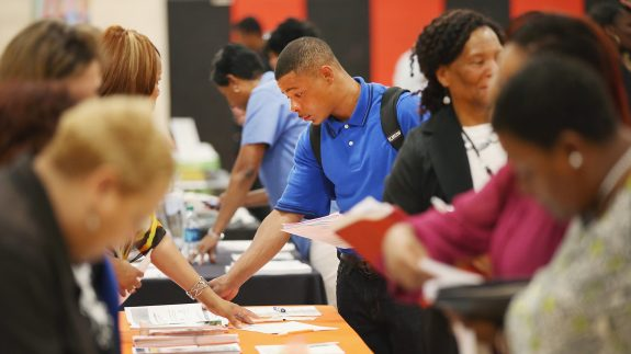 ob seekers check out opportunities at a job fair on June 12, 2014, in Chicago, Illinois. According to the Department of Labor's latest jobs report, unemployment is at 6.3%, the lowest since 2008, when massive layoffs swept through the country. (Photo by Scott Olson/Getty Images)