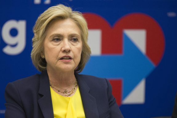 FILE - In this May 12, 2016, file photo, Democratic presidential candidate Hillary Clinton participates in a round table discussion with HIV/AIDS activists at her campaign headquarters in New York. Clinton is closing in fast on the Democratic presidential nomination. After losing three of four state contests in May, Clinton has maintained a lead over Bernie Sanders of 271 pledged delegates won in primaries and caucuses. (AP Photo/Mary Altaffer, File)