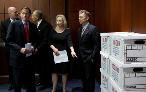 FILE - In this May 24, 2016, file photo, Sen. Kirsten Gillibrand, D-N.Y., second from right, joined by, from left, former chief Air Force prosecutor Ret. Col. Don Christensen, Sen. Richard Blumenthal, D-Conn., Sen. Charles Grassley, R-Iowa, , and Sen. Rand Paul, R-Ky., stand near boxed petition papers to be brought to the White House before the start of a news conference on Capitol Hill in Washington. The Pentagon is relying on information it won't make public to dispute an Associated Press investigation that found the military misled Congress about sexual assault cases to blunt support for Senate legislation. In a report sent May 26 to a bipartisan group of senators, the Pentagon refers to undisclosed files about several of the cases to challenge AP's findings. (AP Photo/Manuel Balce Ceneta, File)