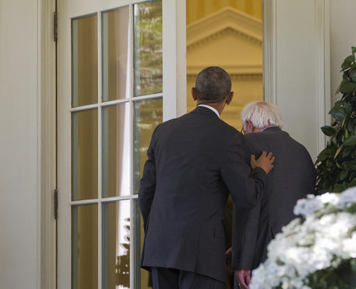 President Barack Obama opens the door to the Oval Office of the White House in Washington, Thursday, June 9, 2016, for Democratic presidential candidate Sen. Bernie Sanders, I-Vt., to begin their meeting. (AP Photo/Pablo Martinez Monsivais)