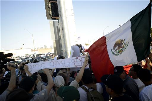 Protesters clash with Donald Trump supporters shortly after the a Donald Trump rally ended in Phoenix, Ariz., on Saturday, June 18, 2016.  (AP Photo/Beatriz Costa-Lima)