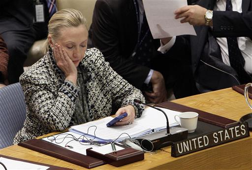Then-Secretary of State Hillary Rodham Clinton checks her mobile phone after her address to the Security Council at United Nations.  (AP Photo/Richard Drew)