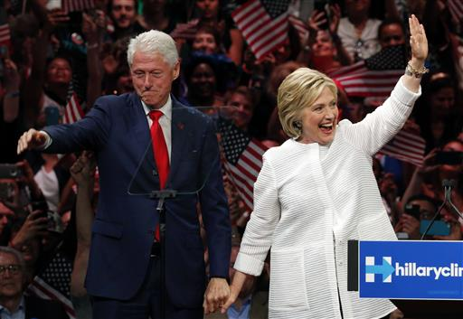 Former President Bill Clinton, left, stands on stage with his wife, Democratic presidential candidate Hillary Clinton, after she spoke during a presidential primary election night rally in New York. His popularity among Democrats is off the charts, he's a fundraising powerhouse and his administration is hailed by many as a high-water mark of economic prosperity. Without question, one of the key assets in Hillary Clinton's second campaign for the White House is her husband, Bill. And yet, there are still times when the former president can step in it. (AP Photo/Julio Cortez, File)