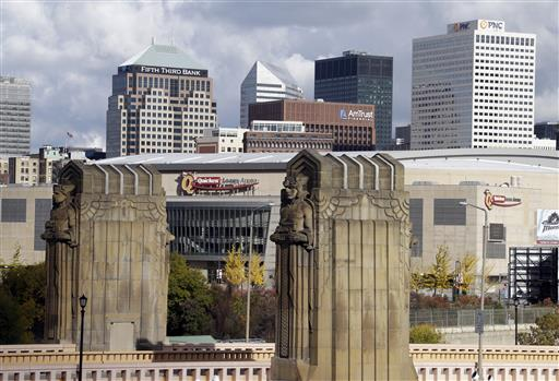 Cleveland's skyline and the venue of the 2016 Republican National Convention, Quicken Loans Arena, framed by the Guardians of Traffic sculptures at the east end of the Hope Memorial Bridge in Cleveland. Donald Trump's effort to unite a splintered Republican Party around his candidacy is about to take center stage in a city that is itself deeply fractured. (AP Photo/Mark Duncan, File)