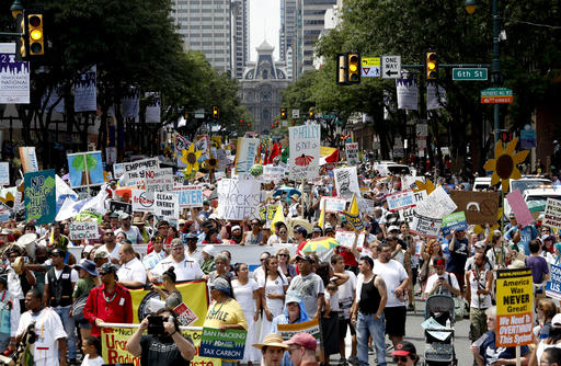 Protesters march during a demonstration in downtown on Sunday, July 24, 2016, in Philadelphia. The Democratic National Convention starts Monday. (AP Photo/Alex Brandon)