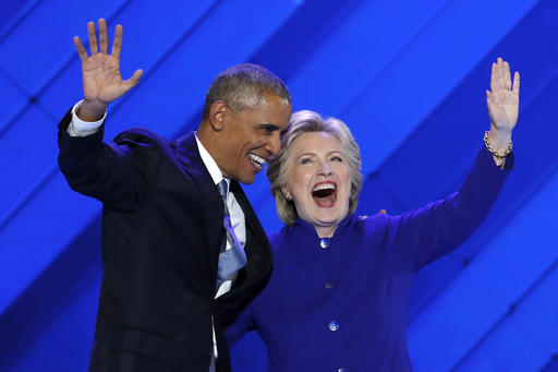 President Barack Obama and Democratic Presidential nominee Hillary Clinton wave to delegates after President Obama's speech during the third day of the Democratic National Convention in Philadelphia , Wednesday, July 27, 2016. (AP Photo/J. Scott Applewhite)
