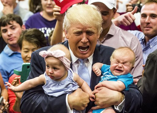 Republican presidential candidate Donald Trump holds baby cousins Evelyn Kate Keane, 6 months old, and Kellen Campbell, 3 months old, following his speech Friday, July 29, 2016, in Colorado Springs, Colo. (Stacie Scott/The Gazette via AP)