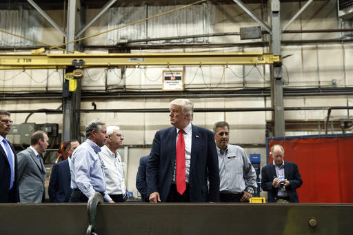 In this Friday, Aug. 12, 2016, photo, Republican presidential candidate Donald Trump takes a tour of McLanahan Corporation headquarters, a company that manufactures mineral and agricultural equipment in Hollidaysburg, Pa. On a Road to 270 that increasingly looks to be uphill climbs and dead ends for Trump in the nation's usual collection of battleground states, the Republican presidential nominee needs a place to reset his Electoral College map. His stops this past week in Michigan and Pennsylvania suggest he's looking at the industrial heartland states on the Great Lakes, a part of the country where he's said he can compete with the Democratic nominee.  (AP Photo/Evan Vucci)