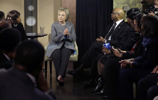 FILE - In this March 5, 2016 file photo, Democratic presidential candidate Hillary Clinton speaks with African American ministers, in Detroit. In the decades since the Voting Rights Act of 1965 widely enfranchised African-Americans, they have become a reliable Democratic bloc. President Barack Obama, the nation's first black president, won at least 95 percent and 93 percent of the black vote in his two victories, sending Republican to historical lows among African-Americans, according to exit polls. (AP Photo/Carlos Osorio, File)