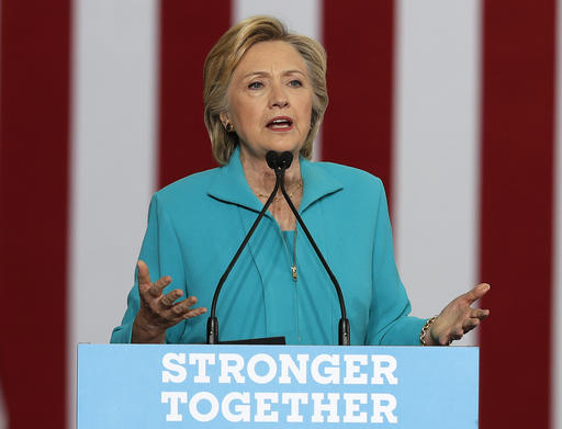 FILE - In this Aug. 25, 2016, file photo, Democratic presidential nominee Hillary Clinton speaks in Reno, Nev. Donald Trump and Clinton are making competing Labor Day pitches in Ohio, setting the stage for a critical month in their testy presidential campaign. (AP Photo/Carolyn Kaster, File)