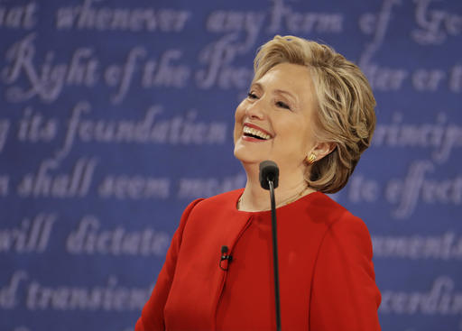 Democratic presidential nominee Hillary Clinton laughs to Republican presidential nominee Donald Trump during the presidential debate at Hofstra University in Hempstead, N.Y., Monday, Sept. 26, 2016. (AP Photo/Julio Cortez)