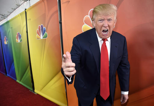 """FILE - In this Jan. 16, 2015 file photo, Donald Trump, host of the television series """"The Celebrity Apprentice,"""" poses for photographers at the NBC 2015 Winter TCA Press Tour in Pasadena, Calif. In his years on the show, Trump repeatedly demeaned women with sexist language, according to show insiders who said he rated female contestants by the size of their breasts and talked about which ones he'd like to have sex with. (Photo by Chris Pizzello/Invision/AP, File)"""