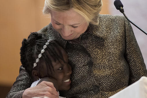 Democratic presidential candidate Hillary Clinton hugs Zianna Oliphant onstage after speaking at the Little Rock AME Zion Church in Charlotte, N.C., Sunday, Oct. 2, 2016. (AP Photo/Andrew Harnik)