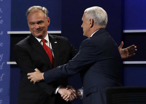 Republican vice-presidential nominee Gov. Mike Pence shakes hands with Democratic vice-presidential nominee Sen. Tim Kaine during the vice-presidential debate at Longwood University in Farmville, Va., Tuesday, Oct. 4, 2016. (AP Photo/Julio Cortez)