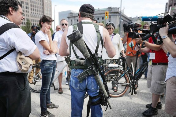 A Trump supporter shows off his weaponry at the Republican National Convention. (NBC News)