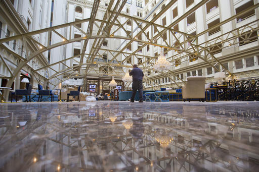 """FILE - This Monday, Sept. 12, 2016, file photo shows a view inside the Trump International Hotel in downtown Washington, during a """"soft opening."""" Republican presidential candidate Donald Trump has suggested that his presidential campaign will boost his hotel business and personal brand. But after a tumultuous run up to the election, including lewd statements about women and derogatory remarks about immigrants, there's some evidence that Trump's brand is being tarnished. (AP Photo/Pablo Martinez Monsivais, File)"""