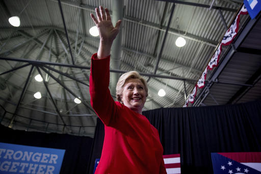 Democratic presidential candidate Hillary Clinton waves to members of the audience as she departs a rally at Kent State University in Kent, Ohio, Monday, Oct. 31, 2016. (AP Photo/Andrew Harnik)