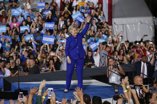 Democratic presidential candidate Hillary Clinton waves to supporters as she arrives at a campaign rally Wednesday, Nov. 2, 2016, in Tempe, Ariz. (AP Photo/Ross D. Franklin)