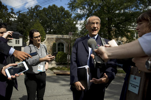 In this photo taken Oct. 5, 2016, Democratic presidential candidate Hillary Clinton's campaign manager John Podesta speaks to members of the media outside Clinton's home in Washington. As early as last December, the Clinton campaign was planning to neutralize Democratic National Committee Chairwoman Debbie Wasserman Schultz and forcing her out after the party convention was one of the options under discussion, according to the latest WikiLeaks release of emails hacked from the accounts of Clinton campaign chairman, John Podesta, which were posted Tuesday, Nov. 11, 2016. (AP Photo/Andrew Harnik)