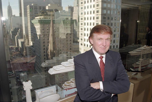 FILE - In this Oct. 25, 1996 file photo, real estate magnate Donald Trump poses for a photo in his office in Manhattan borough of New York. (AP Photo/Anders Krusberg)