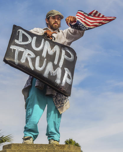 A protester demonstrates in an anti-Trump protest against President-elect, Donald Trump, that started at MacArthur Park and ended at the Edward Royal Federal Building in downtown Los Angeles, Saturday, Nov. 12, 2016. Several thousand people marched through downtown streets Saturday to condemn what they saw as Trump's hate speech about Muslims, pledge to deport people in the country illegally and crude comments about women. (Walt Mancini/The Pasadena Star-News/SCNG via AP)